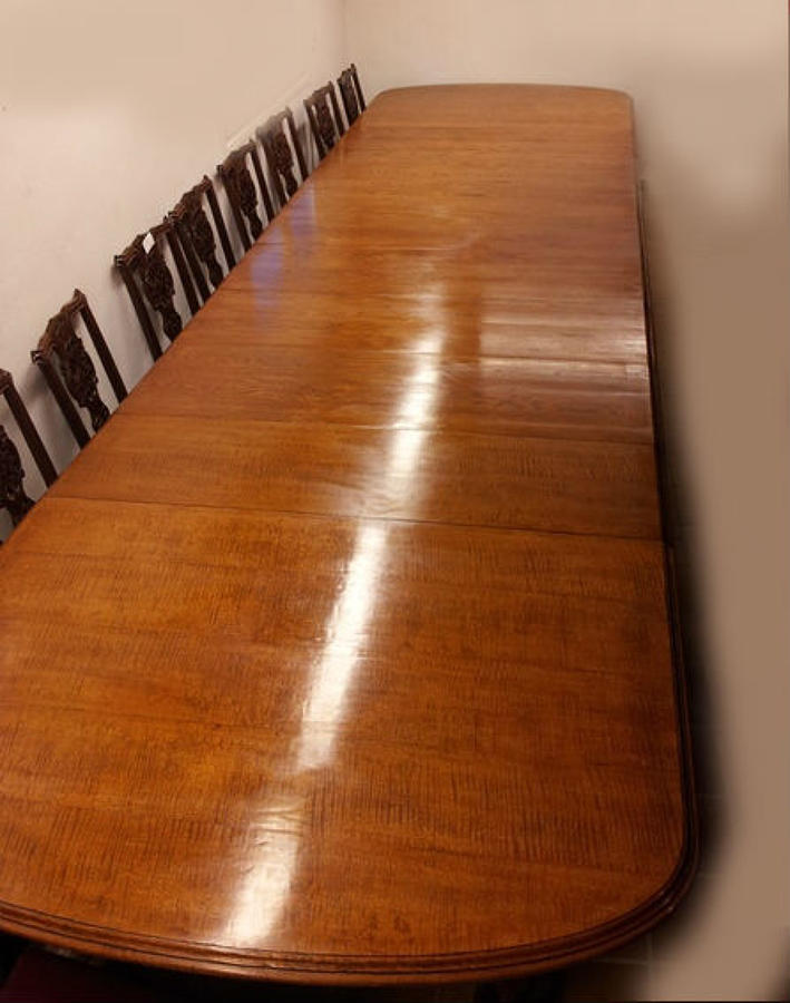 Large oak wind-out dining table with 8 leaves
