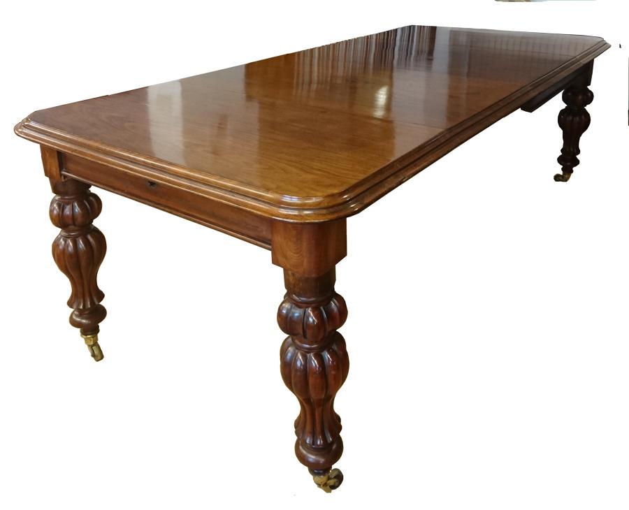 Mesa de comedor antigua de caoba extensible