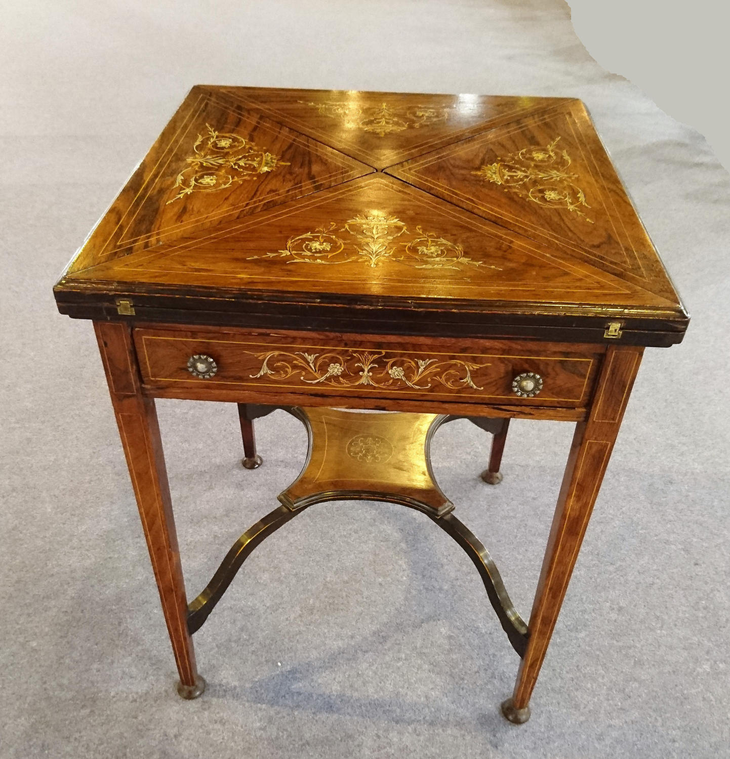 Edwardian rosewood envelope card table