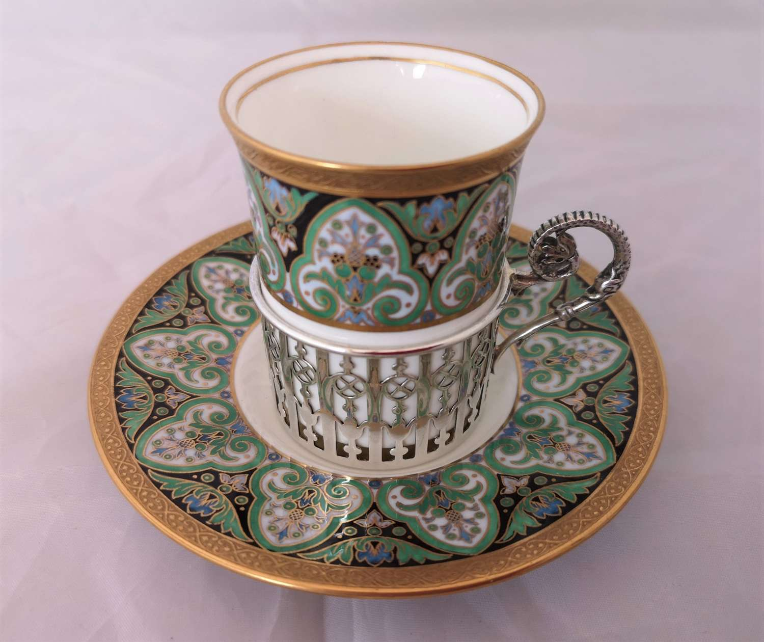 Antique Wedgwood cup and saucer silver holder