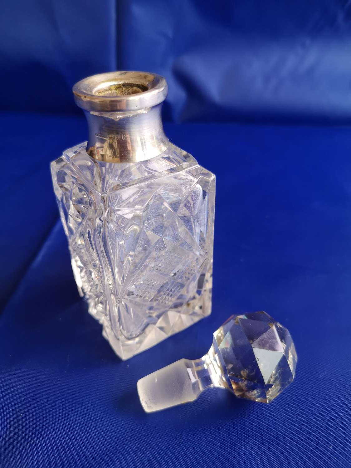 English silver rimmed antique perfume bottle