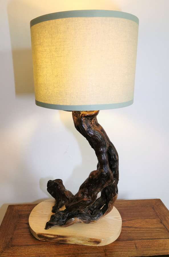 Table lamp made from grapevine wood
