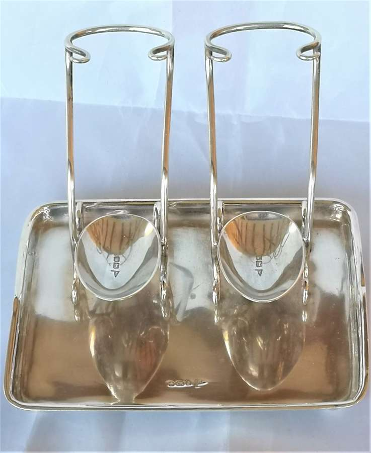 Antigue silver serving spoons stand 1910