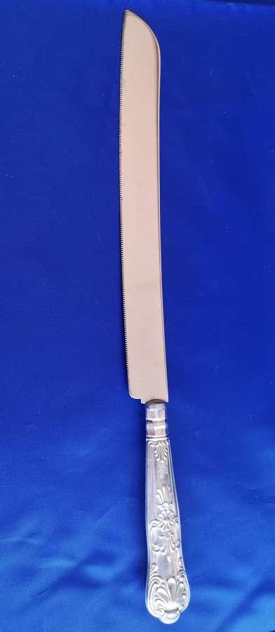 Cuchillo antiguo con mango de plata año 1957